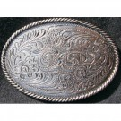 Floral tooled antique Oval belt buckle